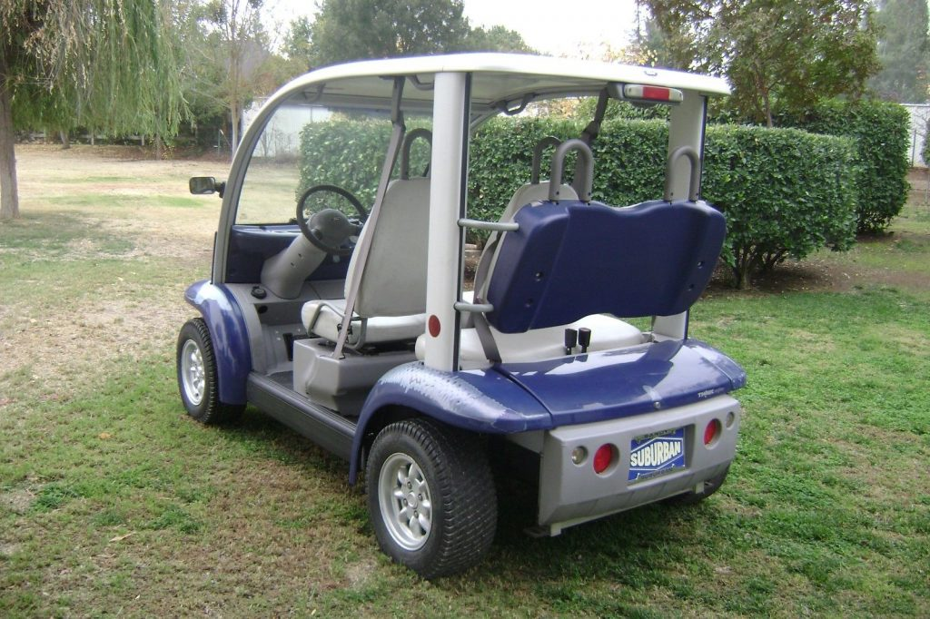 older paint 2002 Ford Think 4 Passenger golf cart