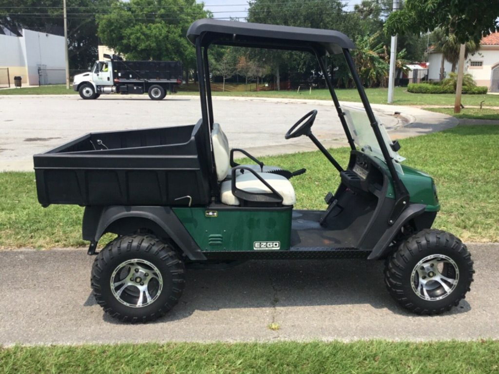 lifted 2014 EZGO golf cart